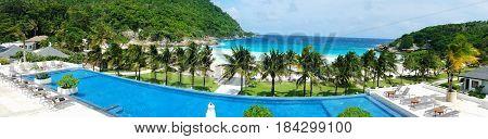 Tropical beach and swimming pool panoramic background in Koh Racha