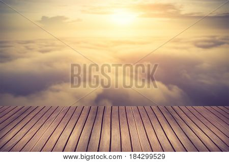 Wood Table Top With Blurred Beautiful Cloudscape- Can Be Used For Display Or Montage Your Products.v