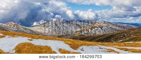 Beautiful Panorama Of Snow Covered Australian Alps And Yellow Grass. New South Wales, Australia