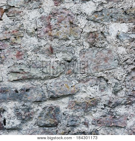 Stone wall background closeup vertical plastered grunge red grey beige stonewall limestone pattern old aged weathered gray lime plaster texture natural grungy textured reddish vintage rough rustic bricks birckwork