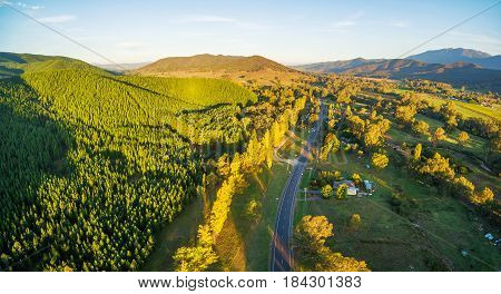 Great Alpine Road Passing Through Australian Countryside At Sunset - Aerial Landscape. Victoria, Aus