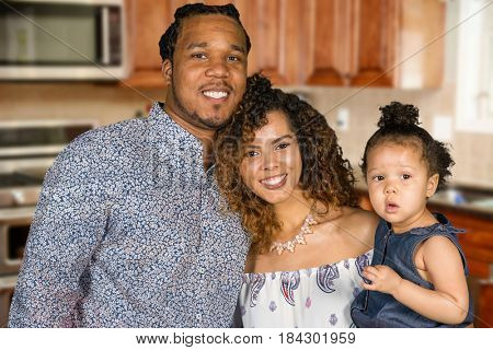 Happy young family with their infant daughter