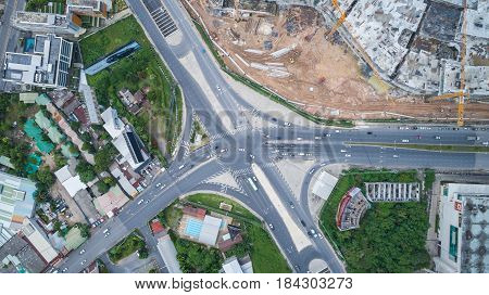 PHUKET THAILAND - APRIL 26 : Top view Darasamuth intersection in Phuket town and car stop in traffic light in Phuket on April 26 2017. Aerial view from flying drone