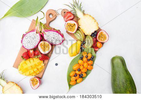 Exotic fruits. Summer photo concept. Mango. Papaya. A pineapple. Avocado. Kiwi. Exotic fruits. Mango. Papaya. A pineapple. Kiwi. Pitahaya. Kumhvat. Copyspase. Fresh fruits