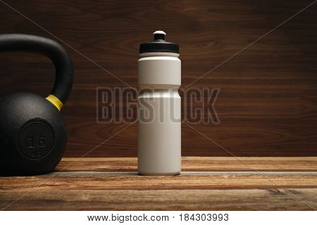 Fitness Equipment And Supplements On Wooden Floor In Gym Fitness Background With Water Bottle Shaker