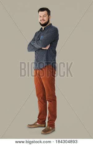 Confident man smiling and arms crossed studio portrait