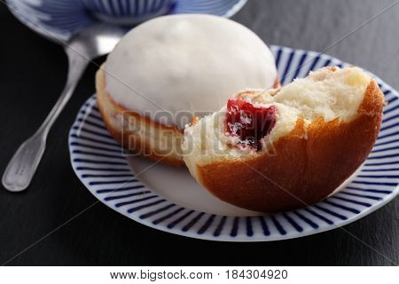 Two donuts with jam on a plate