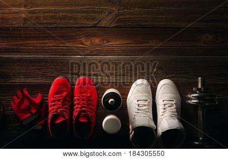 Top View Fitness Equipment And Supplements On Wooden Floor In Gym Fitness Background With Pair Of Sn