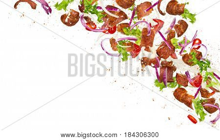 Kebab ingredients flying, close-up. Freeze motion.
