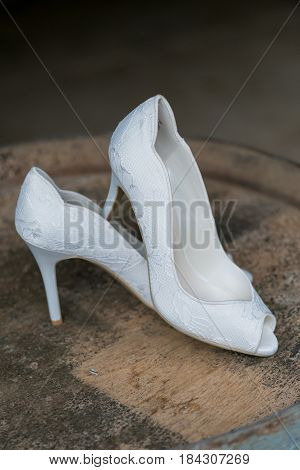 High heel shoes in white for a wedding ceremony to be worn by the bride.