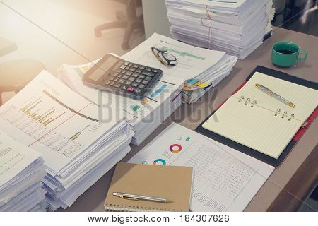 Business Concept Pile of unfinished documents on office desk Stack of business paper Vintage Effect poster