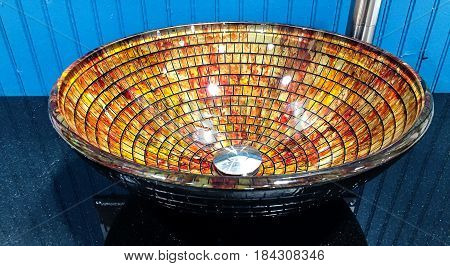 bathroom vanity mosaic sink made of glass, white bathroom sink with rusty drain and running water, selective focus