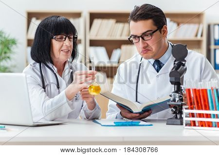Two doctors working in the lab