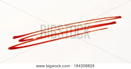 strawberry sauce drizzle on white background