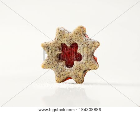 shortbread cookie with jam filing on white background