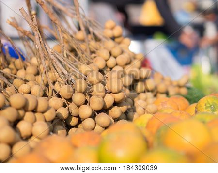 pile of fresh Longan (Dragon's Eye) in market
