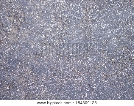 Texture of rough asphalt Dark grey road with small rock and crack Background