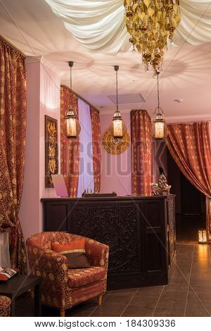 Reception in thai day spa with luxury asian decoration, armchairs and canopy