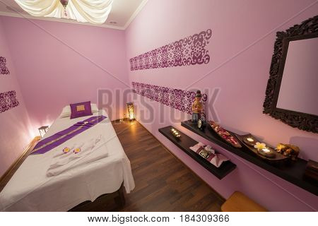 Empty private room with bed for thai massage and asian decoration