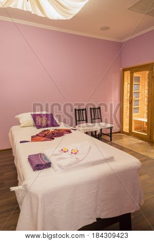Empty light room with white bed for thai massage and asian decoration