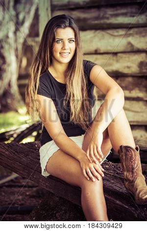 Happy smiling country girl sitting