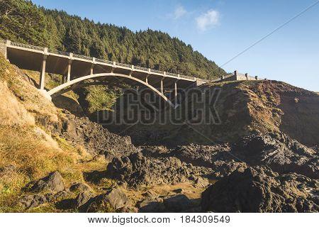 Arch Bridge Over Rocky Ravine
