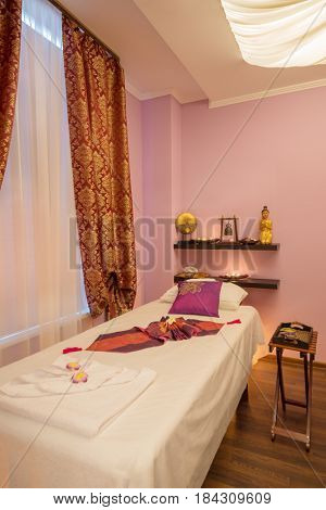 Empty room with white bed for thai massage and asian decoration