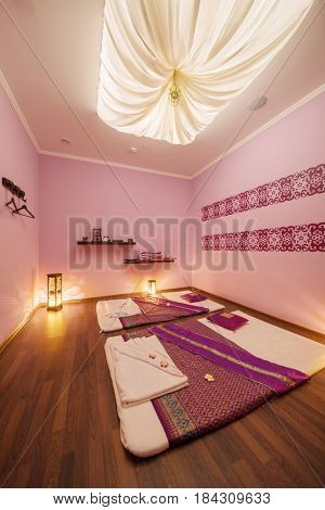 Empty beautiful cozy room with mats for thai massage and canopy top