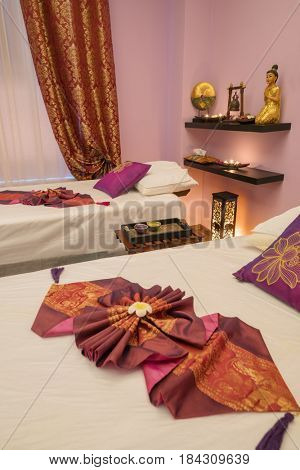 Empty light room with two beds for thai massage and asian decoration