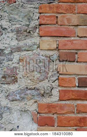 Stone wall background closeup vertical plastered grunge red brick stonewall beige limestone pattern old aged weathered beige lime plaster texture natural grungy textured reddish vintage rough rustic bricks brickwork