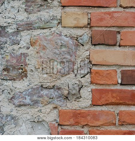 Stone wall background closeup, vertical plastered grunge red brick stonewall, beige limestone pattern, old aged weathered lime plaster texture, natural grungy textured reddish vintage rough rustic bricks brickwork