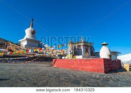 Stupa and prayer flags at the Zheduo Shan Pass Kangding Sichuan China