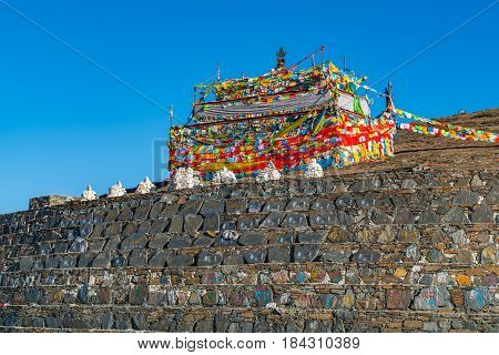 Sichuan China - April 8 2017 : Prayer flags on the hill at Zheduo Shan Pass Kangding Sichuan China