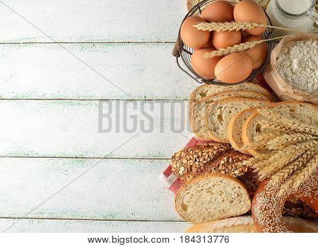 Various bread and wheat on white background rustic food concept