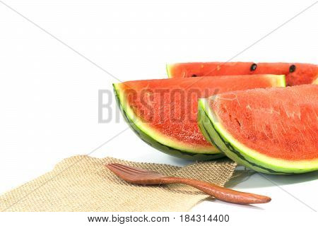 The Watermelon Isolated On White Background With Wood Fork And Sack Cloth