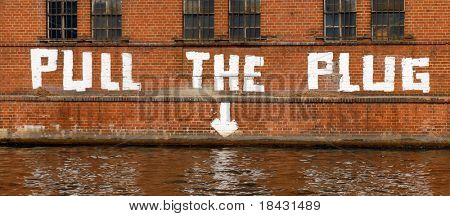 Funny graffiti on the factory wall in Berlin. Spree river bank. German sense of humor.