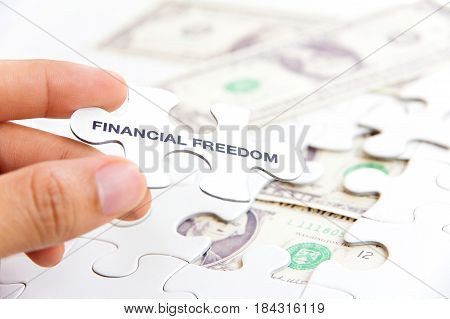 Financial freedom concept. Puzzle pieces financial freedom