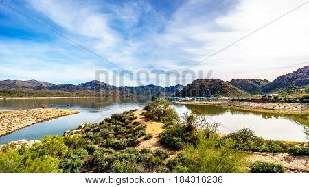 The marina area of Lake Bartlett surrounded by the desert landscape and mountains of Tonto National Forest in Maricopa County, Arizona in the USA
