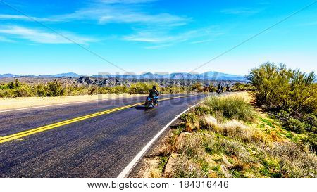 Motor Riders on the curved Bartlett Dam Road between the town of Cave Creek and Lake Bartlett in Tonto National Forest in Maricopa County near Phoenix Arizona in the USA