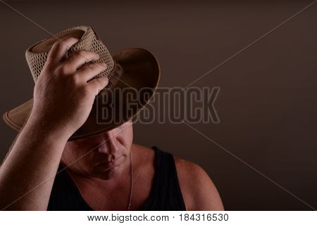 A nice image of a young farm hand in a western style cowboy hat.