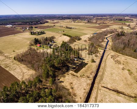 Drone Image. Aerial View Of Rural Area With Fields And Forests