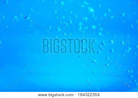 Bubbles up in water on blue background