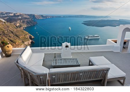 Caldera view and volcano island with cruisers anchored around at Santorini, Greece