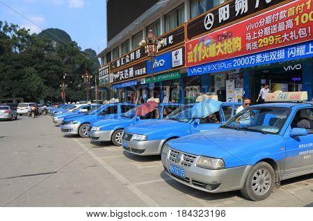 YANGSHOU CHINA - NOVEMBER 18, 2016: Taxis wait for passengers in Yangshou town.
