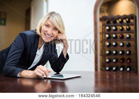 Portrait of businesswoman using digital tablet in a restaurant