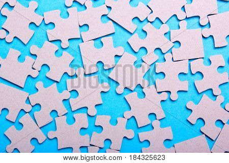 Texture of puzzle pieces on a blue background