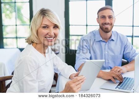 Portrait of smiling executives in a restaurant
