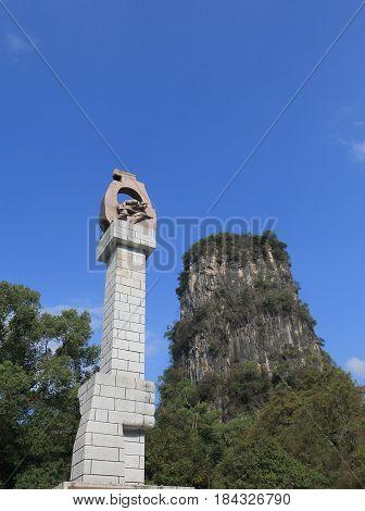 YANGSHOU CHINA - NOVEMBER 18, 2016: Yangshou park monument and karst mountian.
