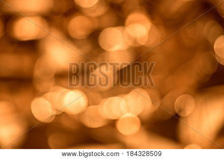 Blurred golden background, abstract background of golden bokeh lights