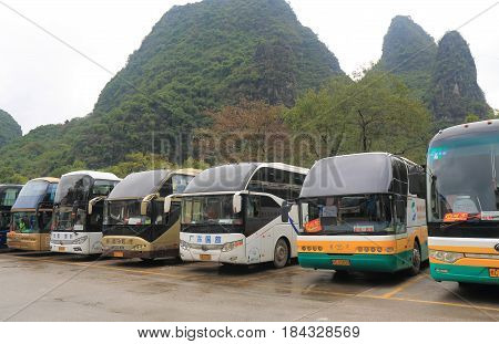 YANGSHOU CHINA - NOVEMBER 19, 2016: tour bus wait for passengers in Xingping historical village.